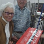 Ted Johnson and Jean Bahnsen touring Lula's Chocolate Factory.