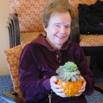 Linda Cook holding her Thanksgiving centerpiece.