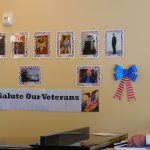 Our Wall of Veterans and Bob Phillips playing patriotic songs for them.