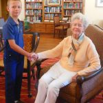 Hayden introducing himself to resident Ms. Nancy Fisher.